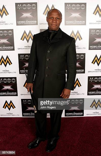 Chris Eubank poses backstage in the awards room having presented the award for Best World Music Act at the MOBO Awards 2005 the tenth anniversary of...