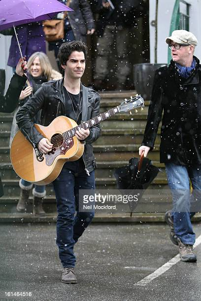 Chris Evans and Kelly Jones seen busking outside The Abbey Road Studios as part of the Please Please Me 50th Anniversary Special Recording Day on...