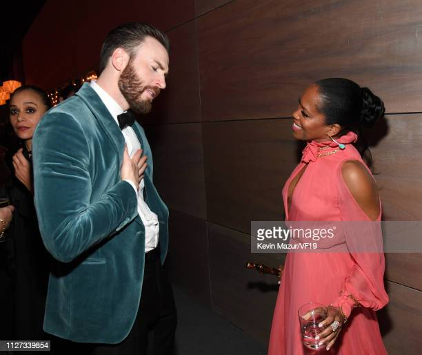 Chris Evans and Regina King attend the 2019 Vanity Fair Oscar Party hosted by Radhika Jones at Wallis Annenberg Center for the Performing Arts on...