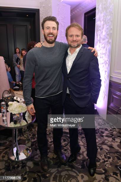 Chris Evans and Rian Johnson attend The Hollywood Reporter TIFF Studio presented by St Regis MAC and Martell at The St Regis Toronto on September 07...
