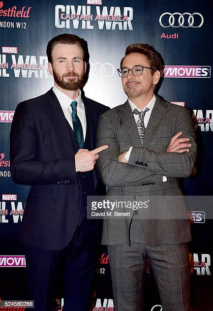 Chris Evans and Robert Downey Jr attend the European Premiere of Captain America Civil War at Vue Westfield on April 26 2016 in London England