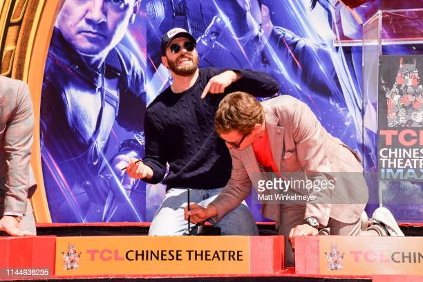Chris Evans and Robert Downey Jr pose at the Marvel Studios' 'Avengers Endgame' Cast Place Their Hand Prints In Cement At TCL Chinese Theatre IMAX...