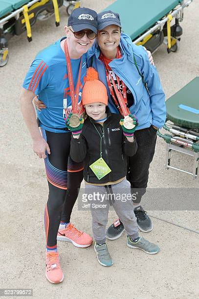 Chris Evans and wife Natasha Shishmanian with their son Noah Evans pose with their medals after completing the Virgin Money London Marathon on April...
