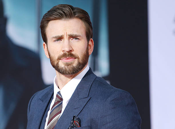 """Chris Evans arrives at the Los Angeles premiere of """"Captain America: The Winter Soldier"""" held at the El Capitan Theatre on March 13, 2014 in..."""