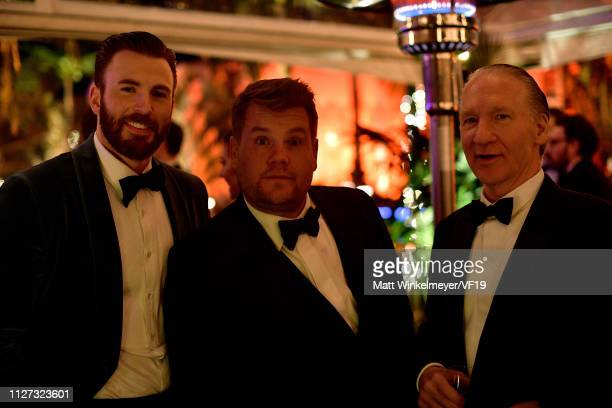 Chris Evans James Corden and Bill Maher attend the 2019 Vanity Fair Oscar Party hosted by Radhika Jones at Wallis Annenberg Center for the Performing...