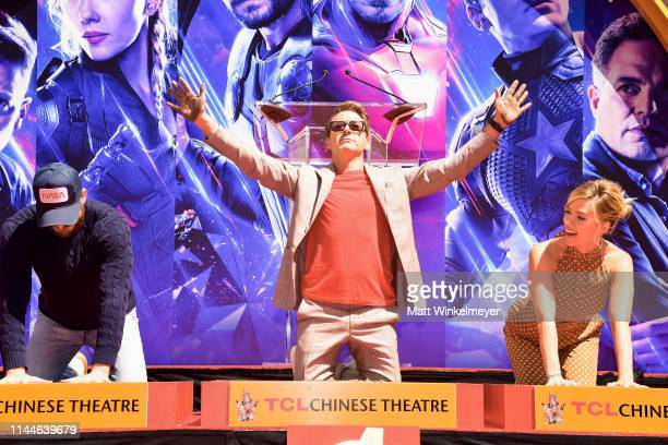 Chris Evans, Robert Downey Jr. And Scarlett Johansson pose at the Marvel Studios' 'Avengers: Endgame' Cast Place Their Hand Prints In Cement At TCL...