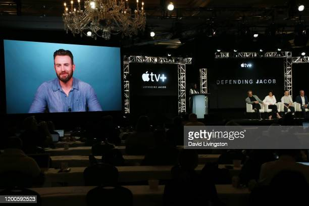 "Chris Evans speaks on the screen with Morten Tyldum, Michelle Dockery, Jaeden Martell and Mark Bomback of ""Defending Jacob"" during the Apple TV+..."