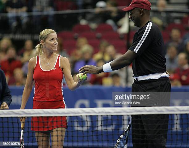 Chris Evert and Clyde Drexler during the Serving for Tsunami Relief tennis match at Toyota Center in Houston Texas Tennis Champion's Jim Courier John...
