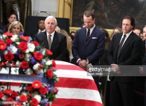 Chris Evert Hale Irwin Peyton Manning and Phil Mickelson pay their respect in front of the casket of the late former President George HW Bush as he...