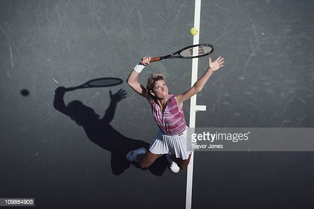 Chris Evert Lloyd of the United States serves to Claudia KohdeKilsch during their Women's Singles QuarterFinal match of the US Open Tennis...