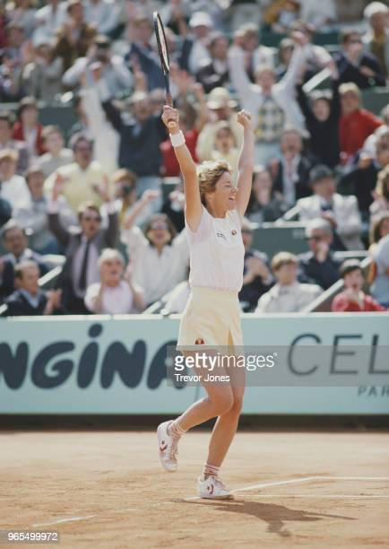 Chris Evert of the United States celebrates her victory over defending champion Martina Navratilova during their Women's Singles Final match at the...