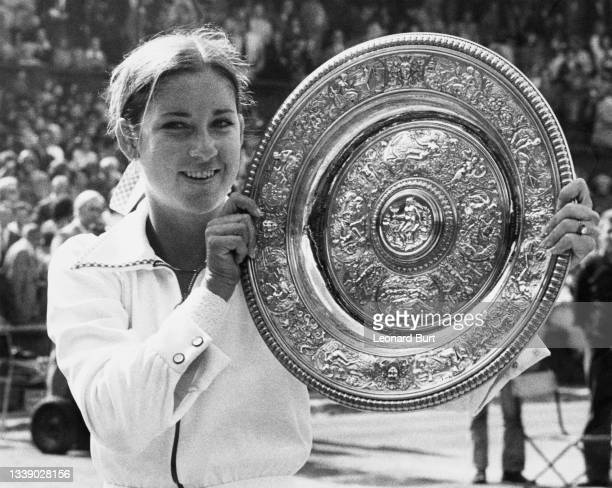 Chris Evert of the United States holds the Venus Rosewater Dish aloft after defeating Olga Morozova of the Soviet Union in their Women's Singles...