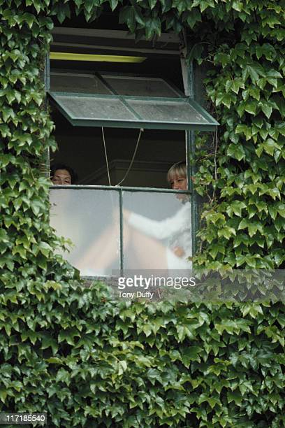 Chris Evert of the United States looks out from the ivy leafed window of the women's dressing room before a Women's Singles match at the Wimbledon...