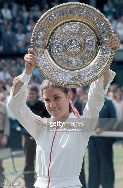 Chris Evert of the United States with the winner's trophy after defeating Olga Morozova in straight sets in the Women's Singles Final at Wimbledon on...