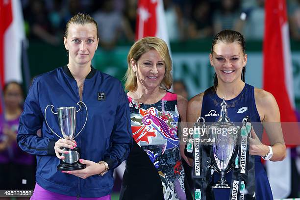 Chris Evert poses with Petra Kvitova of Czech Republic and Agnieszka Radwanska of Poland at the trophy ceremony after their finals match during the...