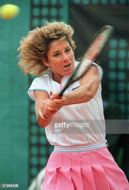 Chris EvertLloyd hits a double backhand to her opponent US Martina Navratilova during their final at the French tennis Open in Paris 07 June 1986...