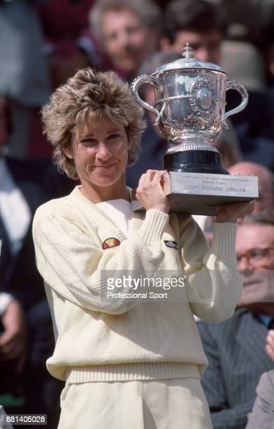 Chris EvertLloyd of the USA lifts the trophy after defeating Martina Navratilova of the USA in the Women's Singles Final of the French Open Tennis...