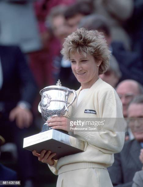 Chris EvertLloyd of the USA poses with the trophy after defeating Martina Navratilova of the USA in the Women's Singles Final of the French Open...