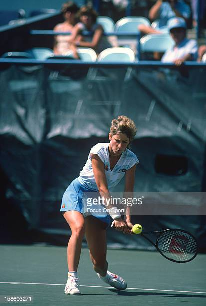 Chris EvertLloyd returns a shot during the Women's 1984 US Open Tennis Championships circa 1984 at the USTA Tennis Center in the Queens borough of...