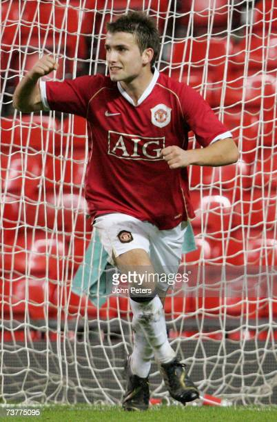 Chris Fagan of Manchester United celebrates Daniel Drinkwater scoring their first goal during the FA Youth Cup semifinal second leg match between...