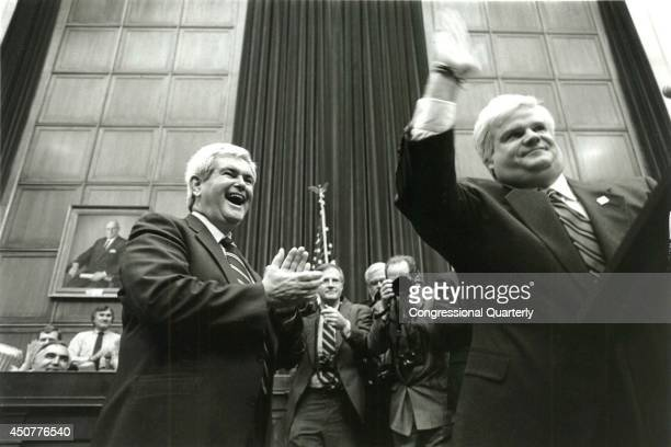 Chris Farley of Saturday Night Live impersonates Speaker of the House Newt Gingrich left who looks on This appearance was an April Fools joke...