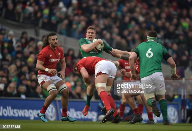 Chris Farrell of Ireland and Josh Navidi of Wales during the Six Nations Championship rugby match between Ireland and Wales at Aviva Stadium on...