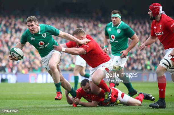 Chris Farrell of Ireland breaks from the tackle of Samson Lee of Wales during the NatWest Six Nations match between Ireland and Wales at Aviva...