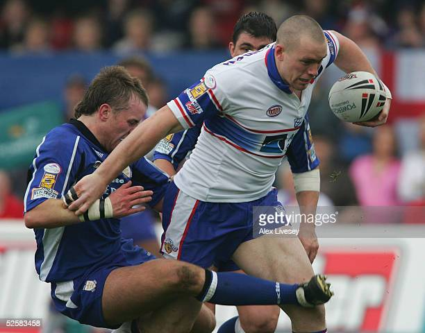 Chris Feather of Wakefield Trinity Wildcats is tackled by Ewan Dowes of Hull during the Powergen Challenge Cup fourth round match between Wakefield...