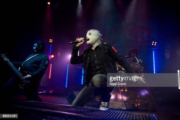 Chris Fehn and Corey Taylor of American metal band Slipknot perform on stage at the Hammersmith Apollo in London on December 2 2008