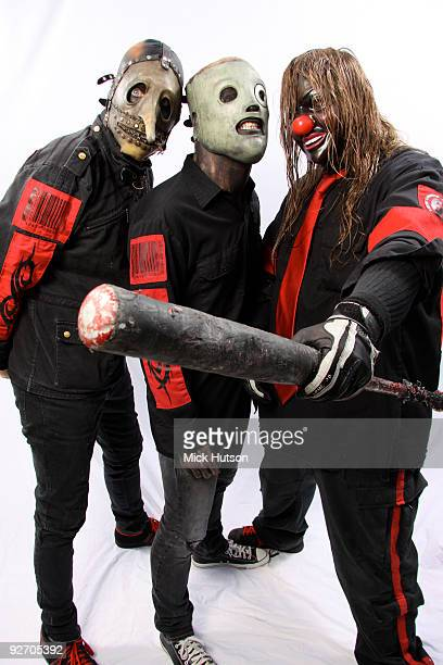 Chris Fehn Corey Taylor and Shawn Crahan of Slipknot pose for a studio portrait session backstage at the Download Festival Donington Park...