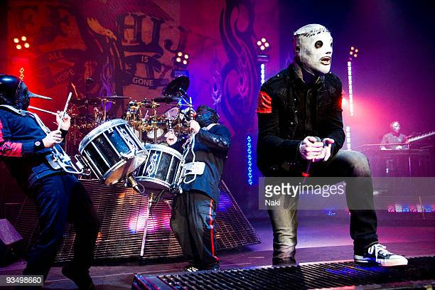 Chris Fehn Shawn 'Clown' Crahan and Corey Taylor of Slipknot perform on stage at Hammersmith Apollo on December 2nd 2008 in London
