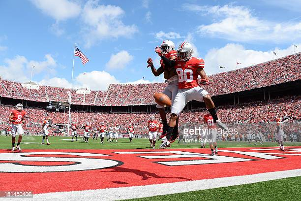 Chris Fields of the Ohio State Buckeyes celebrates his 16-yard touchdown catch in the second quarter against the Florida A&M Rattlers with teammate...