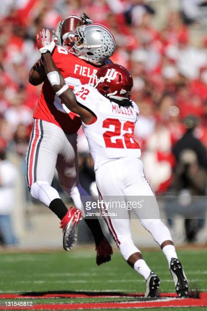 Chris Fields of the Ohio State Buckeyes pulls in a pass reception ahead of the defense of Kenny Mullen of the Indiana Hoosiers at Ohio Stadium on...
