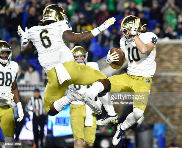 Chris Finke celebrates with Tony Jones Jr. #6 of the Notre Dame Fighting Irish after scoring a touchdown against the Duke Blue Devils during the...