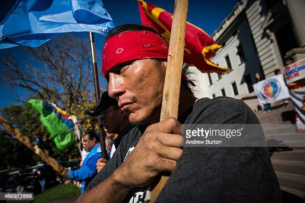Chris Firethunder, a member of the Oglala Lakota Native American tribe, participates in a protest against the proposed Keystone XL pipeline on...