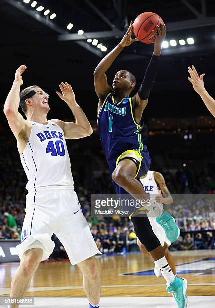 Chris Flemmings of the North CarolinaWilmington Seahawks drives to the basket against Marshall Plumlee of the Duke Blue Devils in the first half of...