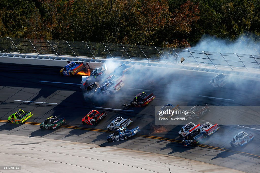 Chris Fontaine, driver of the #78 Glenden Enterprises Toyota, Brandon Brown, driver of the #86 Brandonbilt Motorsports Chevrolet, and Korbin Forrister, driver of the #5 All Secure Toyota, are involved in an on-track incident during the NASCAR Camping World Truck Series fred's 250 at Talladega Superspeedway on October 22, 2016 in Talladega, Alabama.