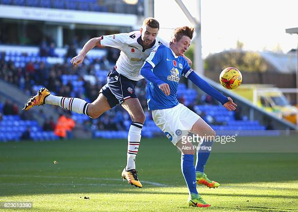 Chris Forrester of Peterborough United and Mark Beevers of Bolton Wanderers in action during the Sky Bet League One match between Peterborough United...