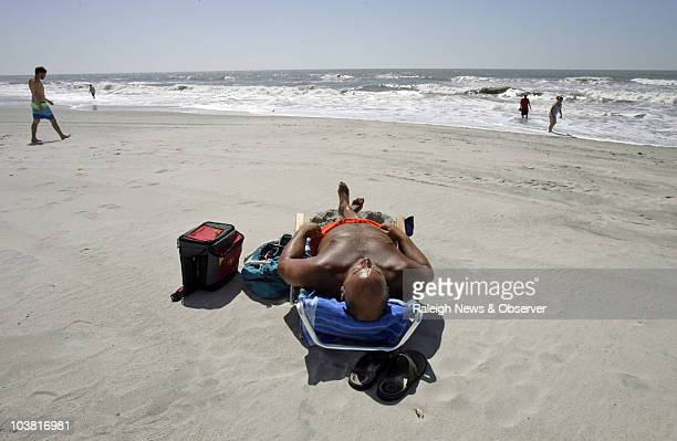 Chris Fournier of New Bern catches some rays on Atlantic Beach North Carolina Friday September 3 2010 People on the Crystal Coast were relieved by...