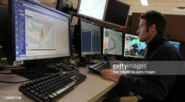 Chris Franks, general forecaster at the National Weather Service in Chanhassen MN., worked on the short term forecast as he looked at computer...