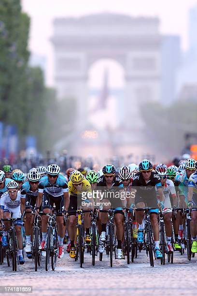 Chris Froome of Great Britain and SKY Procycling rides in the bunch during the twenty first and final stage of the 2013 Tour de France a processional...