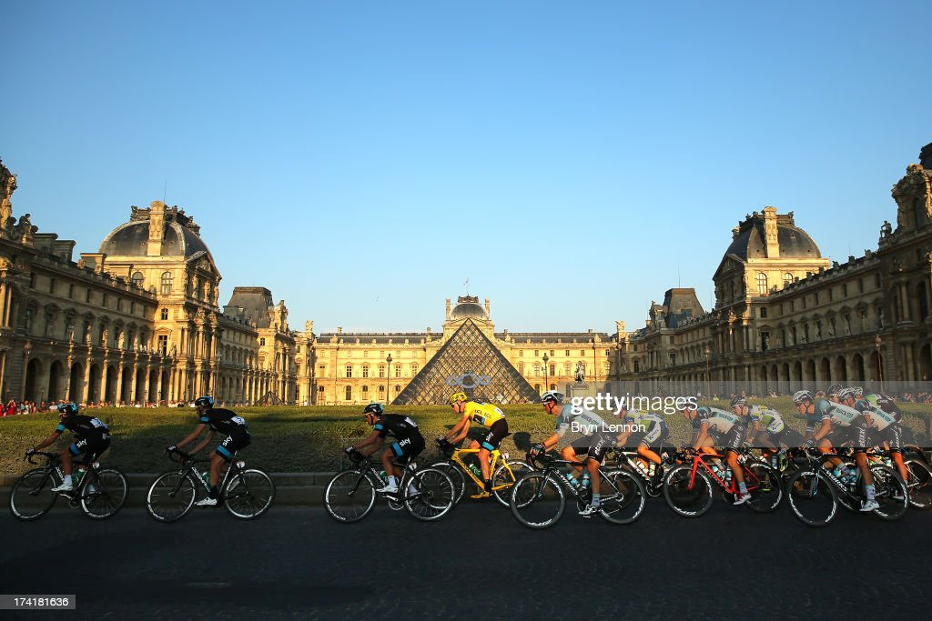 Chris Froome of Great Britain and SKY Procycling (C) rides in the pack during the twenty first and final stage of the 2013 Tour de France, a processional 133.5KM road stage ending in an evening race around the Champs-Elysees, on July 21, 2013 in Paris, France.