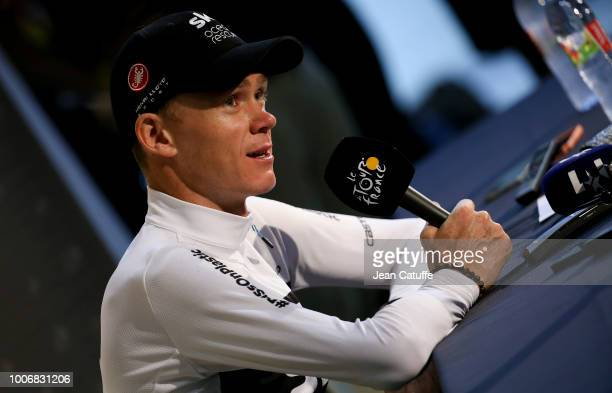 Chris Froome of Great Britain and Team Sky answers to the media during a press conference following stage 20 of Le Tour de France 2018 an individual...