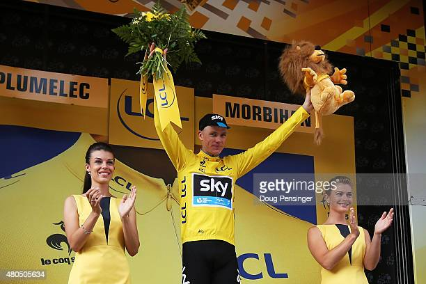 Chris Froome of Great Britain and Team Sky celebrates after retaining the yellow jersey during stage nine of the 2015 Tour de France, a 28km team...