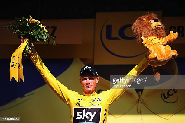 Chris Froome of Great Britain and Team Sky celebrates after retaining the overall leader's yellow jersey after stage thirteen of the 2015 Tour de...