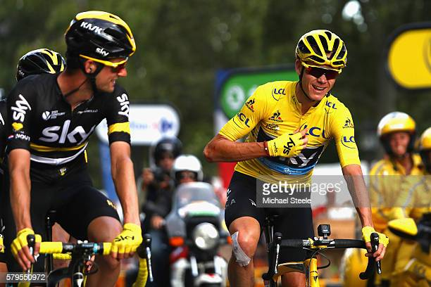 Chris Froome of Great Britain and Team Sky celebrates as he crosses the finish line in stage twenty one of the 2016 Le Tour de France from Chantilly...