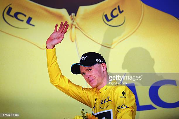 Chris Froome of Great Britain and Team Sky celebrates as he is awarded the yellow jersey on the podium after stage three of the 2015 Tour de France,...