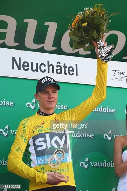Chris Froome of Great Britain and Team Sky celebrates claiming the overall race victory and yellow jersey after his victory in the 185km individual...