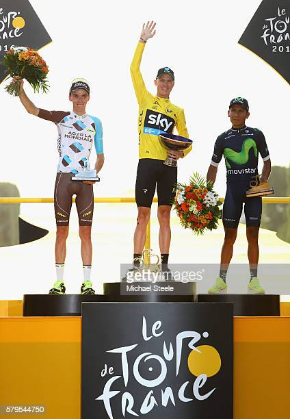 Chris Froome of Great Britain and Team Sky celebrates finishing first Romain Bardet of France and AG2R La Mondial Team celebrates finising second and...