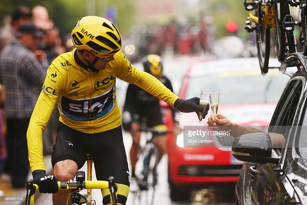 Chris Froome (yellow) of Great Britain and Team Sky celebrates his overall victory with a glass of champagne during the twenty first stage of the 2015 Tour de France, a 109.5 km stage between Sevres and Paris Champs-Elysees, on July 26, 2015 in Paris, France.